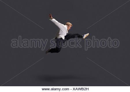 Studio shot of young man practicing martial arts