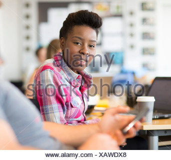 Young woman in creative office, portrait - Stock Photo