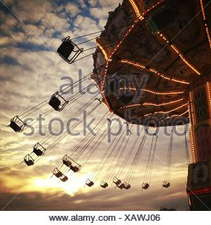 Silhouette of a Carousel ride at an amusement park - Stock Photo