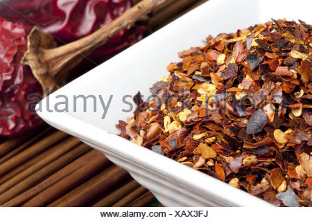 Coarsely ground red pepper - Stock Photo