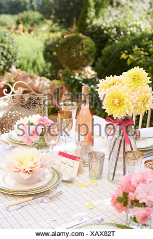 Table set for wedding reception outdoors - Stock Photo