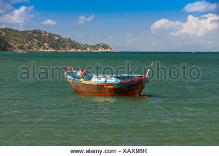 Fishing boat, Hon, Mun, bay, Vinpearl, island, South China Sea, sea, Asian, Asia, outside, mountains, mountainous, landscape, isl - Stock Photo