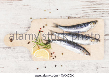 Delicious anchovies fish eating. - Stock Photo