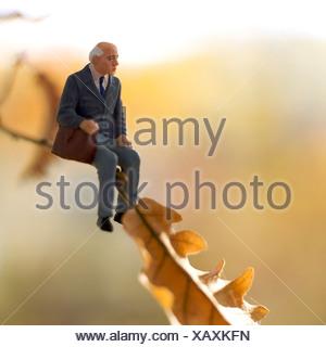Solitary elderly male figure sitting alone - Stock Photo