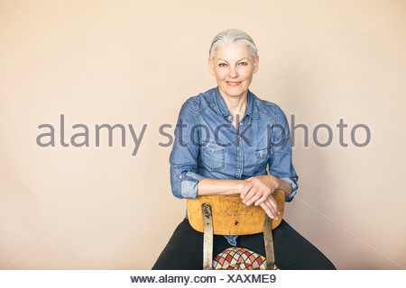 Woman in confident pose - Stock Photo