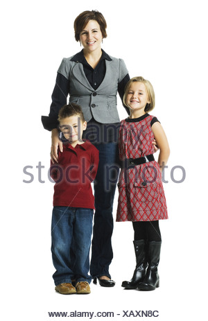 Woman with two children smiling - Stock Photo