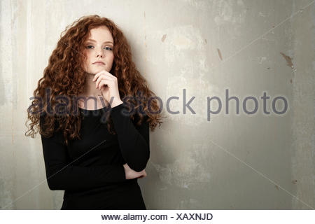 Portrait of redheaded teenage girl - Stock Photo