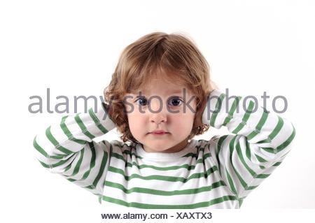 ears to keep shut child - Stock Photo