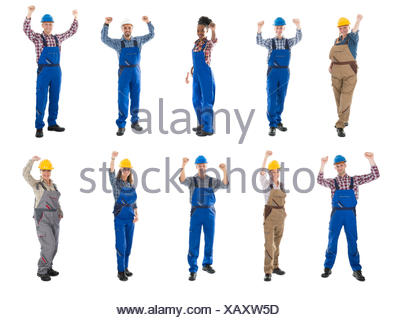 Portrait Of Successful Male Carpenters Standing In Row - Stock Photo