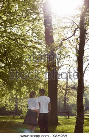 Couple walking in a forest Copenhagen Denmark. - Stock Photo