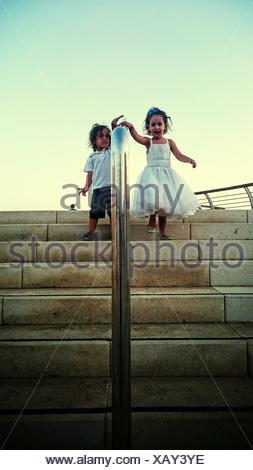 Kids Walking Down Stairs - Stock Photo