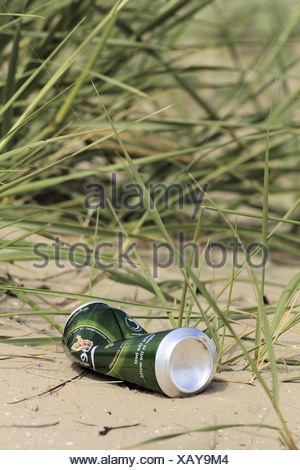 Empty beer can discarded on beach. - Stock Photo