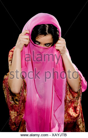 Arabian woman wearing traditional dress on black background - Stock Photo