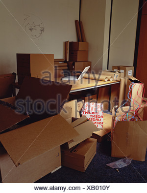Cardboard boxes in office - Stock Photo