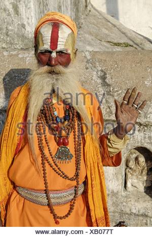 Sadhu holy man Pashupatinath Katmandu Nepal Himalayas Asia Asian asceticism ascetic ascetically beard whiskers painted face - Stock Photo