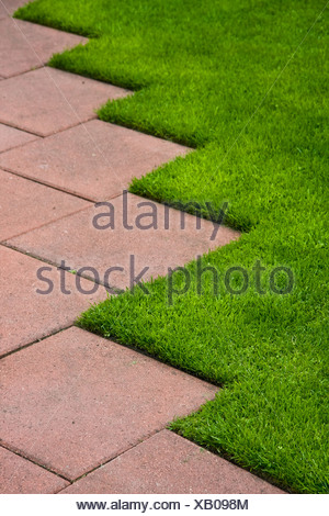 lawn,stone plate,paving slab - Stock Photo