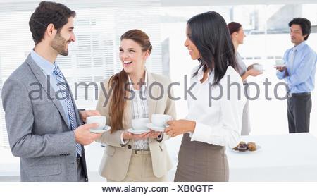 Business people enjoying their drinks - Stock Photo