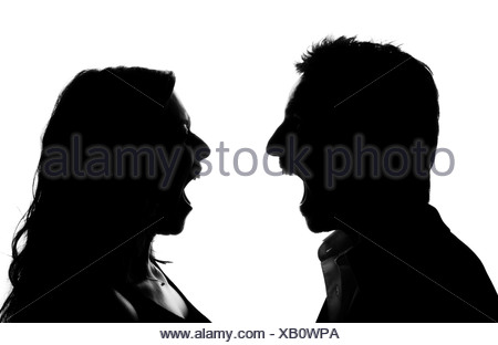Silhouette, woman and man screaming at each other, argument - Stock Photo