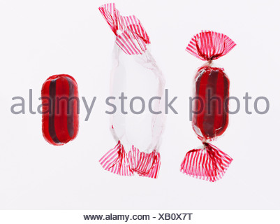 Wrapped and unwrapped hard candy - Stock Photo