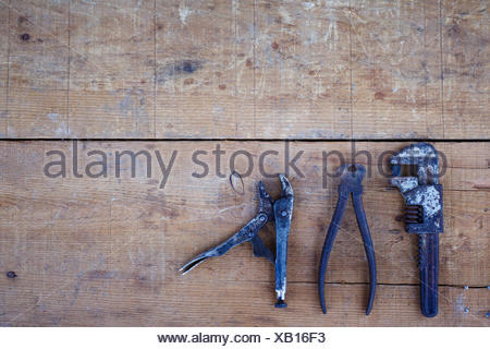 High Angle View Of Rusty Tools On Wooden Table - Stock Photo