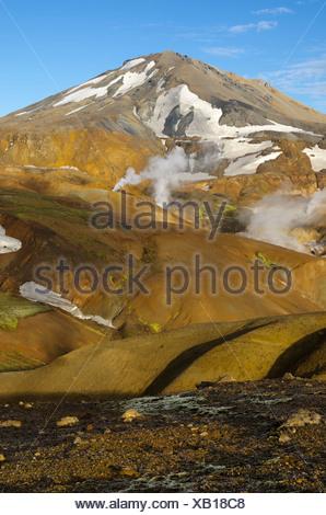 Hot springs and snow-capped Rhyolite Mountains, Hveradallir high temperature region, Kerlingarfjoell, highlands, Iceland, Europe - Stock Photo