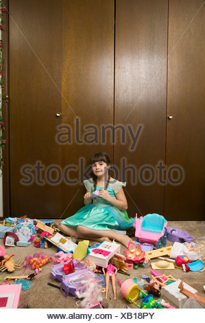Young girl making a mess while playing - Stock Photo