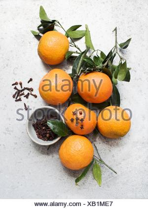 Overhead view of oranges decorated with cloves - Stock Photo