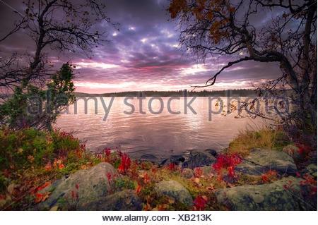 View of lake at dusk - Stock Photo