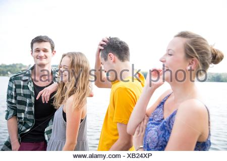 Group of young adults, outdoors, laughing - Stock Photo