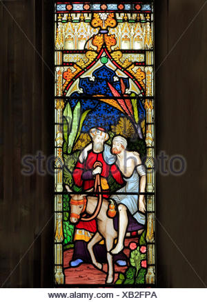 Parable of The Good Samaritan, stained glass by Frederick Preedy, 1865, Traveller carried on a Donkey to an Inn by Good Samaritann, Gunthorpe, Norfolk - Stock Photo