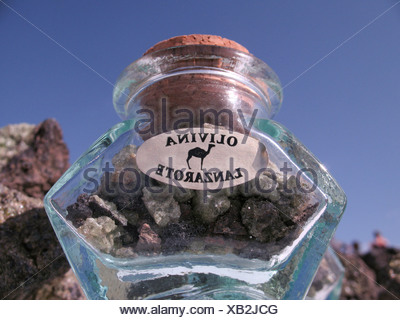 Olivine, semi-precious stone, can be found on El Golfo beach, Lanzarote, Canary Islands, Spain, Europe - Stock Photo