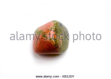Cutout of an Unakite gemstone on white background - Stock Photo