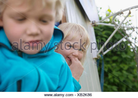 Portrait of two young cute blonde kids boy girl