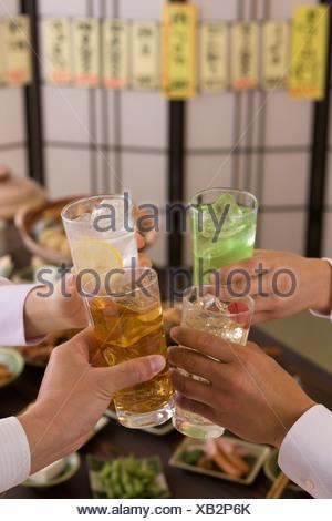 Four People Toasting with Various Chu-Hi at Izakaya - Stock Photo