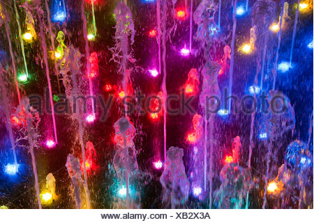 Fountain light show. - Stock Photo