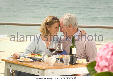 Couple dining at seaside restaurant Stock Photo