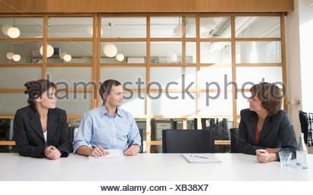 Three people in meeting - Stock Photo