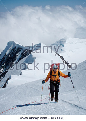Woman makes her way to Windy Corner on the West Buttress Route, Kahiltna Glacier on Mt. McKinley, Denali National Park - Stock Photo