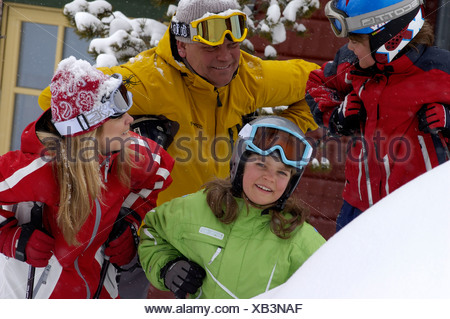 Portrait of a family on ski vacation. - Stock Photo