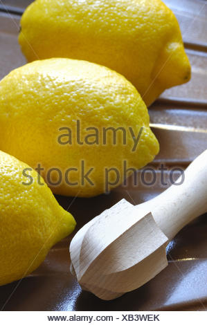 Lemons, citrus juicer, detail, - Stock Photo