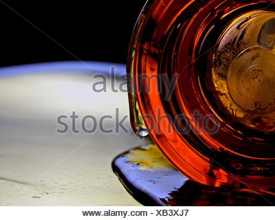 Abstract honey drip from glass - Stock Photo