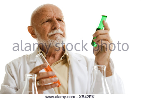 Scientist with chemicals in test tubes and beakers - Stock Photo