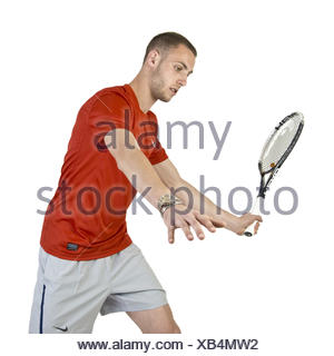 Young man playing tennis. - Stock Photo
