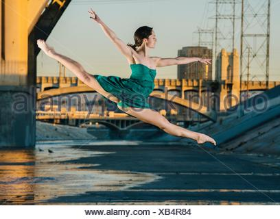 Young female dancer leaping in mid air, Los Angeles, USA - Stock Photo