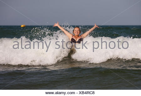 Woman has sent a wave - Stock Photo