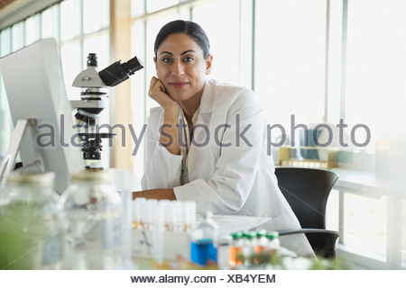 Portrait of botanist working in laboratory - Stock Photo