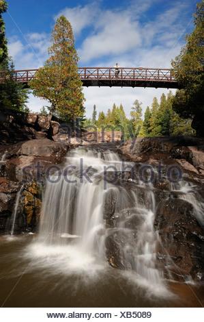 MR Wooden foot bridge Fifth Falls Waterfall Gooseberry Falls State Park North Shore Minnesota USA America United States of - Stock Photo