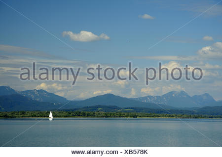 sailing boat on Lake Chiemsee with mountain scenery, Germany, Bavaria - Stock Photo