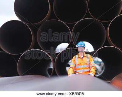 Man checking pipes - Stock Photo