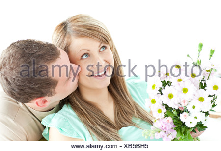 Caring man giving a bouquet to his girlfriend - Stock Photo